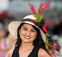 BALTIMORE, MD - MAY 20: A woman in a festive hat poses for a photo on the apron of the grandstand on Preakness Stakes Day at Pimlico Race Course on May 20, 2017 in Baltimore, Maryland.(Photo by Douglas DeFelice/Eclipse Sportswire/Getty Images)