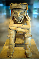 Sculpted pre-Mayan civilization era clay figure represents Xipe-Totec, God of Spring. Museo de Antropologia (Museum of Anthropology)Veracruz, Xalapa (Jalapa), Mexico.