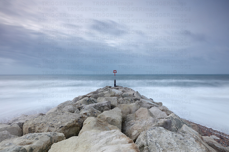 Stone jetty on seascape