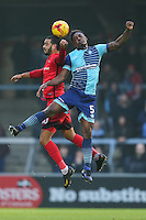 Paul McCallum of Leyton Orient (10) and Anthony Stewart of Wycombe Wanderers  battle for the ball during the Sky Bet League 2 match between Wycombe Wanderers and Leyton Orient at Adams Park, High Wycombe, England on 17 December 2016. Photo by David Horn / PRiME Media Images.