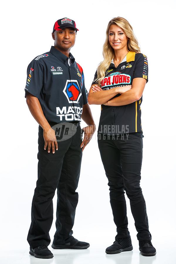 Jan 11, 2018; Brownsburg, IN, USA; NHRA top fuel driver Leah Pritchett (right) and Antron Brown pose for a portrait during a photo shoot at Don Schumacher Racing. Mandatory Credit: Mark J. Rebilas-USA TODAY Sports