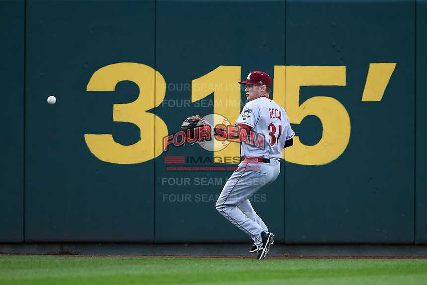 Frisco RoughRiders outfielder Preston Beck (31) fields a hit at the warning track during a game against the Springfield Cardinals  on June 4, 2015 at Hammons Field in Springfield, Missouri.  Frisco defeated Springfield 8-7.  (Mike Janes/Four Seam Images)