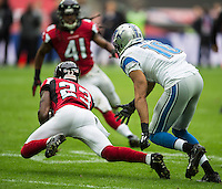 26.10.2014.  London, England.  NFL International Series. Atlanta Falcons versus Detroit Lions. Falcons' CB Robert Alford [23] intercepts a pass intended for Lions' WR Corey Fuller [10]