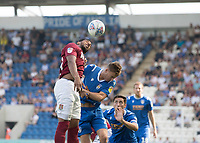 Vadaine Oliver of Northampton Town just wins the aerial ball during Colchester United vs Northampton Town, Sky Bet EFL League 2 Football at the JobServe Community Stadium on 24th August 2019