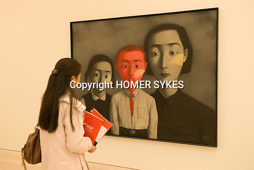 The Saatchi Gallery. The Duke of York Headquarters, Chelsea, London UK 2008. The Revolution Continues: New Art from China. A Big Family by Zhang Xiaogang.