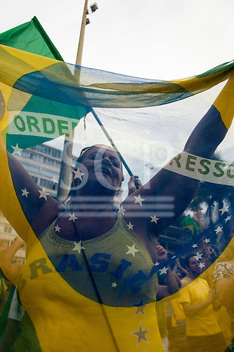 Woman protestor holds a Brazilian flag. Rio de Janeiro, Brazil, 15th March 2015. Demonstration against President Dilma Rousseff.