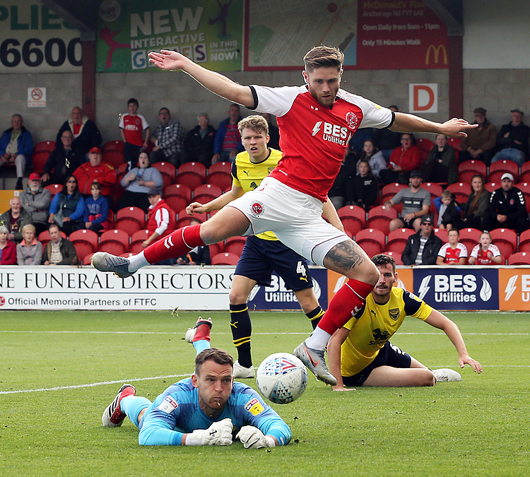 Fleetwood Town's Wes Burns competes with Oxford United's Simon Eastwood<br /> <br /> Photographer Rich Linley/CameraSport<br /> <br /> The EFL Sky Bet League One - Fleetwood Town v Oxford United - Saturday 7th September 2019 - Highbury Stadium - Fleetwood<br /> <br /> World Copyright © 2019 CameraSport. All rights reserved. 43 Linden Ave. Countesthorpe. Leicester. England. LE8 5PG - Tel: +44 (0) 116 277 4147 - admin@camerasport.com - www.camerasport.com