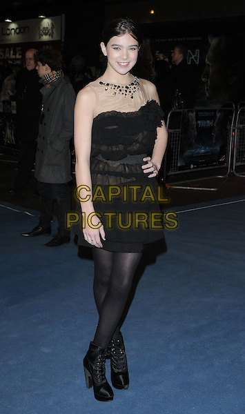 "HAILEE STEINFELD .At the ""Tron: Legacy"" UK Film Premiere, Empire cinema, Leicester Square, London, England, UK, .December 5th 2010..full length hayley mesh sleeveless beige nude  black dress tights hand on hip shoes .CAP/CAN.©Can Nguyen/Capital Pictures."