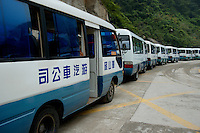 Line of tourist buses parked on Mount Hua, one of China's five Sacred Taoist Mountains, in Shaanxi, China.