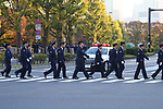 Police officers walk before the royal parade to mark the enthronement of Japanese Emperor Naruhito in Tokyo, Japan on Sunday, November 10, 2019. (Photo by AFLO)