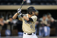 Jake Mueller (6) of the Wake Forest Demon Deacons at bat against the Davidson Wildcats at David F. Couch Ballpark on February 28, 2017 in Winston-Salem, North Carolina.  The Demon Deacons defeated the Wildcats 13-5.  (Brian Westerholt/Four Seam Images)