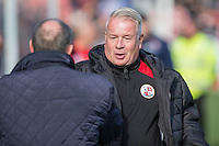 Cheltenham manager Gary Johnson (foreground) greets Crawley manager Dermot Drummy ahead of the Sky Bet League 2 match between Cheltenham Town and Crawley Town at the LCI Rail Stadium, Cheltenham, England on 15 October 2016. Photo by Mark  Hawkins.
