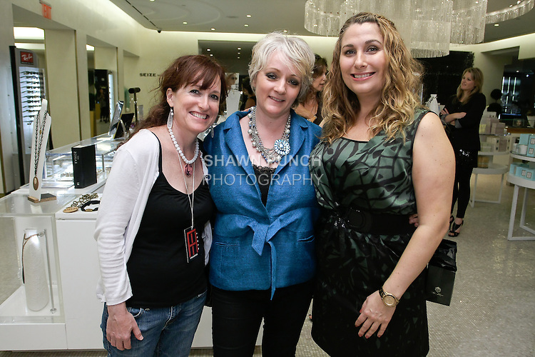 Susan Nestor, Kathleen Hodge and  Plaza Beauty Manager pose together at The Plaza Hotel's Fashion's Night Out event during New York Fashion Week, September 8, 2011.