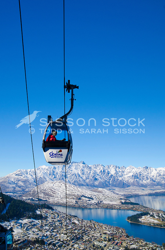 Tourists view the Remarkables, Queenstown and Lake Wakatipu from the Skyline Gondola in winter, South Island, New Zealand