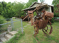 NWA Democrat-Gazette/ANDY SHUPE<br /> A found-object metal sculpture stands Friday, May 26, 2017, in front of a house at 130 E. Rock Street in south Fayetteville.