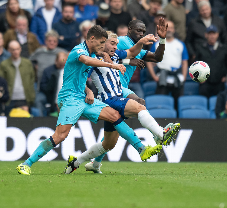 Brighton & Hove Albion's Neal Maupay (centre) battles for possession with Tottenham Hotspur's Erik Lamela (left) and Moussa Sissoko (right) <br /> <br /> Photographer David Horton/CameraSport<br /> <br /> The Premier League - Brighton and Hove Albion v Tottenham Hotspur - Saturday 5th October 2019 - The Amex Stadium - Brighton<br /> <br /> World Copyright © 2019 CameraSport. All rights reserved. 43 Linden Ave. Countesthorpe. Leicester. England. LE8 5PG - Tel: +44 (0) 116 277 4147 - admin@camerasport.com - www.camerasport.com