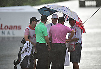 Bethesda, MD - July 2, 2017: Charles Howell III and Kyle Stanley seek cover under an officials umbrella on the seventeenth hole as play is suspended because of a heavy rainfall during final round of professional play at the Quicken Loans National Tournament at TPC Potomac at Avenel Farm in Bethesda, MD.  (Photo by Phillip Peters/Media Images International)