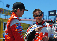 Apr 24, 2009; Talladega, AL, USA; NASCAR Sprint Cup Series driver Greg Biffle (right) speaks with Kasey Kahne during practice for the Aarons 499 at Talladega Superspeedway. Mandatory Credit: Mark J. Rebilas-