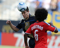 Sebastien Le Toux #9 of the Philadelphia Union heads the ball away from Julian de Guzman #6 of Toronto FC during an MLS match at PPL stadium in Chester, PA. on July 17 2010. Union won 2-1 with a last minute penalty kick goal.