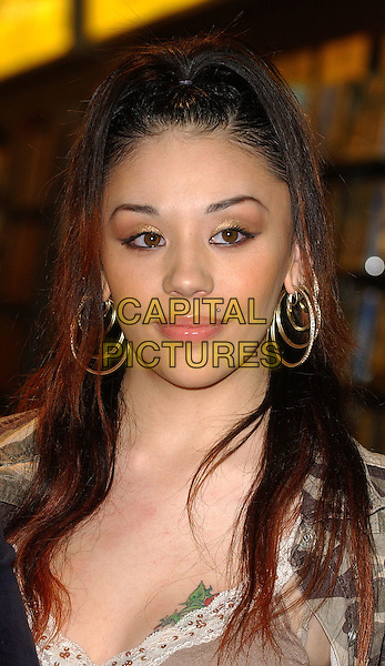 MUTYA BUENA .The Sugababes cut the ribbon at the official opening of the new HMV in Stratford, East London. .29th September 2005 .Ref: BEL.headshot portrait piercings hoop earrings.www.capitalpictures.com.sales@capitalpictures.com.© Capital Pictures.