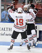 Wade MacLeod (Northeastern - 19), Steve Silva (Northeastern - 17) and Tyler McNeely (Northeastern - 94) celebrate Silva's goal. - The visiting Merrimack College Warriors defeated the Northeastern University Huskies 4-3 (OT) on Friday, February 4, 2011, at Matthews Arena in Boston, Massachusetts.