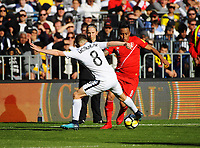 New Zealand's Michael McGlinchey tackles Peru's Wilder Cartagena during the 2018 FIFA World Cup Russia first-leg playoff football match between the NZ All Whites and Peru at Westpac Stadium in Wellington, New Zealand on Saturday, 11 November 2017. Photo: Dave Lintott / lintottphoto.co.nz