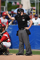 Umpire Donnie Smith during the first game of a doubleheader between the Williamsport Crosscutters and Batavia Muckdogs on July 29, 2014 at Dwyer Stadium in Batavia, New York.  Williamsport defeated Batavia 3-2.  (Mike Janes/Four Seam Images)
