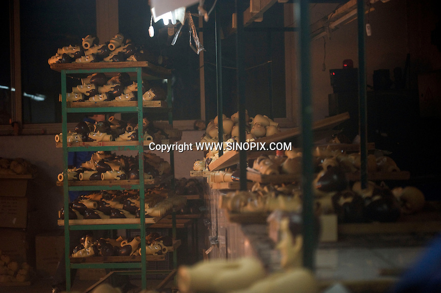 """Workers in the moulding department at Shanghai Fashion Plastics that makes the """"Woody"""" toy that features in the new Disney film Toy Story 3 that is going to be the biggest movie event of the year for children.<br /><br /><br />Photos by Richard Jones/sinopix"""