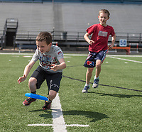 NWA Democrat-Gazette/ANTHONY REYES @NWATONYR<br /> Brothers Ethan McCrary (left), 10, and Jacob McCrary, 9, chase a flying disc Tuesday, March 21, 2017 while playing with their older brother and other friends at David Gates Stadium in Rogers. The group was enjoying the nice weather during their spring break vacation.