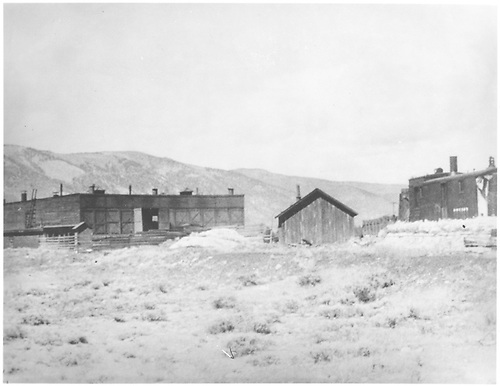 Front view of C&amp;S Leadville roundhouse with the rotary snowplow stored outside for the summer.<br /> C&amp;S  Leadville, CO  1939