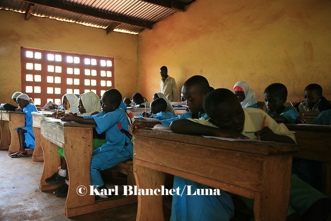 Pupils in a classroom of the Islamic school in Sunyani, Ghana, listening to the teacher. In Ghana, coranic schools were transformed into islamic schools. Pupils learn the mainstream curriculum and have additional courses in arabic and islam.