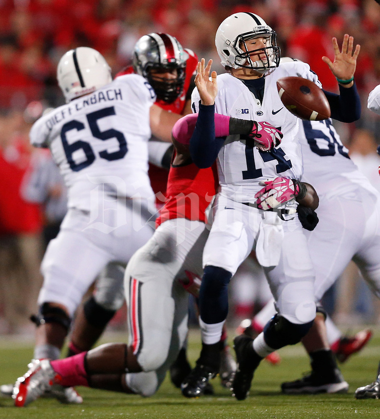 Penn State Nittany Lions quarterback Christian Hackenberg (14) loses the football as he is tackled by Ohio State Buckeyes defensive lineman Noah Spence (8) during Saturday's NCAA Division I football game at Ohio Stadium on October 26, 2013. (Barbara J. Perenic/The Columbus Dispatch)