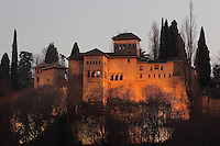 The Tower of the Ladies or Partal, or Torre de las Damas at night, built under Muhammad III in the 14th century, in the old Palacio del Partal, Alhambra Palace, Granada, Andalusia, Southern Spain. The Alhambra was begun in the 11th century as a castle, and in the 13th and 14th centuries served as the royal palace of the Nasrid sultans. The huge complex contains the Alcazaba, Nasrid palaces, gardens and Generalife. Granada was listed as a UNESCO World Heritage Site in 1984. Picture by Manuel Cohen