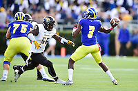Newark, DE - OCT 29, 2016: Towson Tigers linebacker Diondre Wallace (56) in pursuit of Delaware Fightin Blue Hens quarterback Joe Walker (3) during game between Towson and Delaware at Delaware Stadium Tubby Raymond Field in Newark, DE. (Photo by Phil Peters/Media Images International)