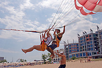Sunny Beach, Nesebar, Bulgaria..Paragliders and unfinished hotels and apartments at Sunny Beach, the largest holiday resort in the Balkans, and a popular destination for cheap foreign package tours. Rapid overdevelopment of the Back Sea coast has led to widespread environmental destruction, and many properties lie uncompleted or empty.