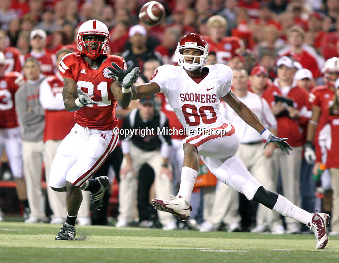 Nebraska defensive back Prince Amukamara intercepts a pass intended for Oklahoma's Adron Tennell during the second quarter of Saturday's game at Memorial Stadium in Lincoln, NE. Amukamara returned the interception, the first of five for Nebraska, 22 yards to the Oklahoma 1 to set up a touchdown one play later. Nebraska took a 7-0 lead and went on to upset No. 20 Oklahoma 10-3..