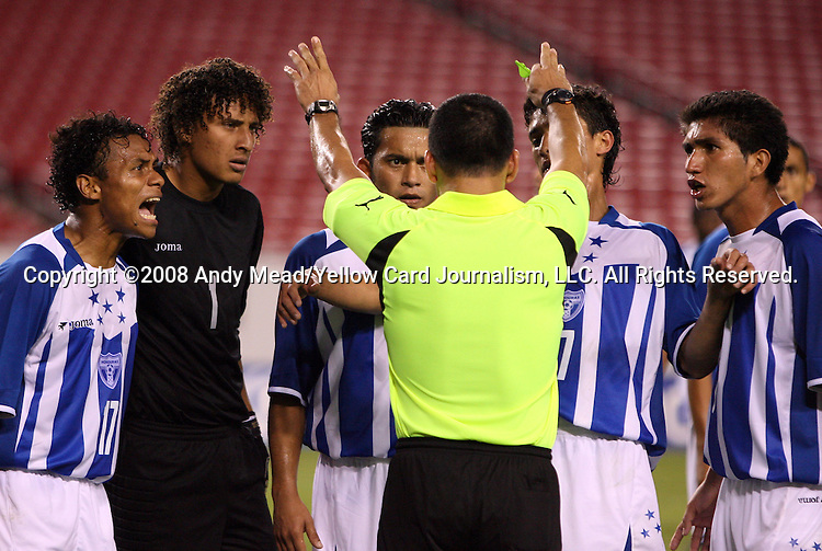 15 March 2008: Referee Erico Wijngaarde (SUR) (in yellow) is surrounded by Honduras players after awarding a penalty kick to the United States. The United States U-23 Men's National Team defeated the Honduras U-23 Men's National Team 1-0 at Raymond James Stadium in Tampa, FL in a Group A game during the 2008 CONCACAF's Men's Olympic Qualifying Tournament.