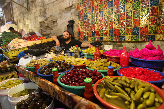 A Palestinian vendor sells pickles in his shop at a market in the West Bank city of Nablus, on Aug. 10, 2011. Muslims around the world are observing the holy fasting month of Ramadan where they refrain from eating, drinking, smoking from dawn to dusk.  Photo by Wagdi Eshtayah