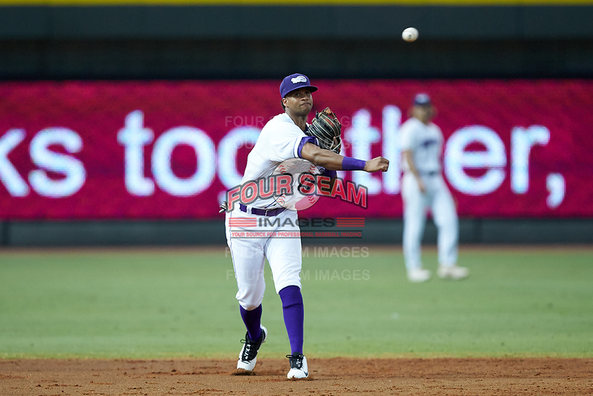 Winston-Salem Dash shortstop Johan Cruz (13) makes a throw to first base against the Lynchburg Hillcats at BB&T Ballpark on August 1, 2019 in Winston-Salem, North Carolina. The Dash defeated the Hillcats 9-7. (Brian Westerholt/Four Seam Images)
