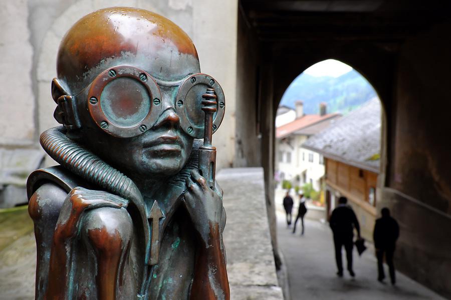 Hans Rudolf Giger's statue Birth Machine Baby outside HR Giger Museum, Gruyères, Switzerland, Europe