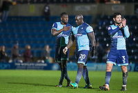 Aaron Pierre (left) of Wycombe Wanderers puts a hand on the badge as he looks towards the support during the Sky Bet League 2 match between Wycombe Wanderers and Plymouth Argyle at Adams Park, High Wycombe, England on 14 March 2017. Photo by Kevin Prescod / PRiME Media Images.