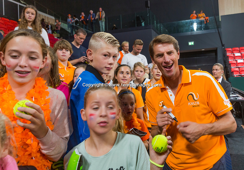The Hague, The Netherlands, September 17, 2017,  Sportcampus , Davis Cup Netherlands - Chech Republic, Kids press-conference, Captain Paul Haarhuis (NED) signing autographs<br /> Photo: Tennisimages/Henk Koster