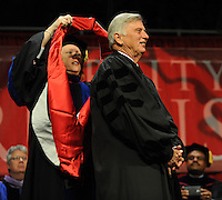 NWA Media/ANDY SHUPE - Gov. Mike Beebe, right, smiles as Sharon Gaber, provost and vice chancellor for academic affairs at the University of Arkansas, bestows upon him an honorary degree during fall commencement exercises Saturday, Dec. 20, 2014, at Barnhill Arena on the university campus in Fayetteville.