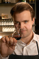 The interior of the wine bar Terrenos Vinotek. The head waiter Michael Mobach tasting a glass of wine.  Stockholm, Sweden, Sverige, Europe