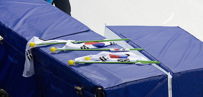 February 24 2010: Vancouver 2010  Olympics, Korean flags are left behind by a dejected Korean woman's short track relay team after being disqualified.