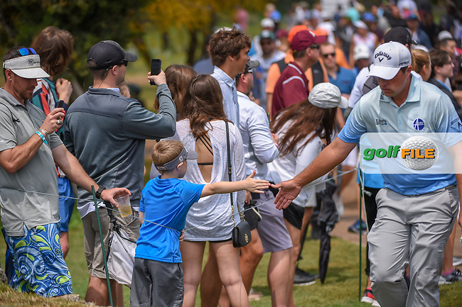Brian Stuard (USA) high fives a young fan enroute to the tee on 11 during day 3 of the Valero Texas Open, at the TPC San Antonio Oaks Course, San Antonio, Texas, USA. 4/6/2019.<br /> Picture: Golffile | Ken Murray<br /> <br /> <br /> All photo usage must carry mandatory copyright credit (© Golffile | Ken Murray)