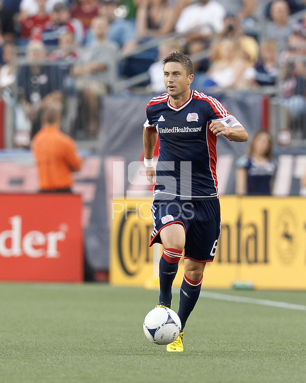 New England Revolution defender Chris Tierney (8) looks to pass. In a Major League Soccer (MLS) match, Sporting Kansas City defeated the New England Revolution, 1-0, at Gillette Stadium on August 4, 2012.