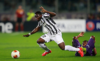 Calcio, ritorno degli ottavi di finale di Europa League: Fiorentina vs Juventus. Firenze, stadio Artemio Franchi, 20 marzo 2014. <br /> Juventus midfielder Kwadwo Asamoah, of Ghana, and Fiorentina midfielder Juan Cuadrado, of Colombia, right, fight for the ball during the Europa League round of 16 second leg football match between Fiorentina and Juventus at Florence's Artemio Franchi stadium, 20 March 2014. Juventus won 1-0 to advance to the round of eight.<br /> UPDATE IMAGES PRESS/Isabella Bonotto