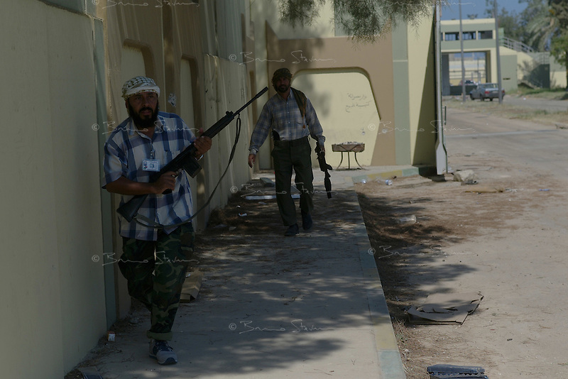 Tripoli, Libya, August 24, 2011.Rebel troops have stormed Khaddafi's  Bab Aziziya complex; however heavy incoming fire continued to land on the site, causing panic among the fighters..