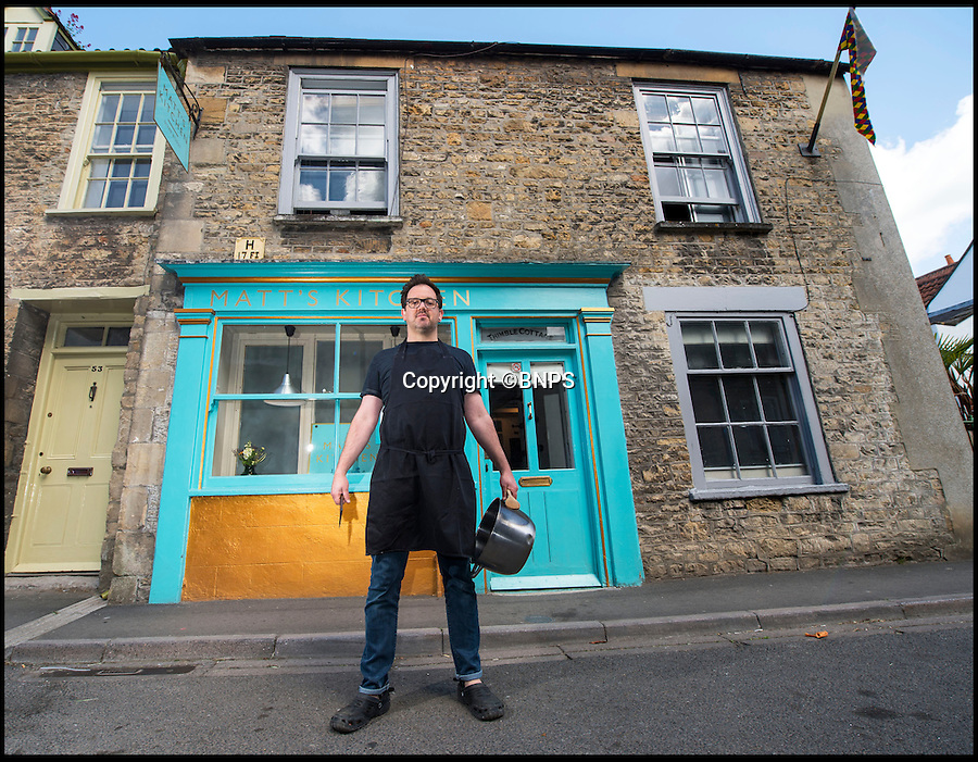 BNPS.co.uk (01202 558833)<br /> Pic: PhilYeomans/BNPS<br /> <br /> Chef Matt Watson outside his home and restaurant.<br /> <br /> Unconventional chef Matt Watson is cooking up a storm with his new restaurant - which he's opened in his front room.<br /> <br /> Despite only having one standard oven to cook with and no formal training, Matt Watson, 43, shifted his sofas to one side and launched his unlikely venture, and now business is booming.<br /> <br /> The self-taught cook, who got an E in home economics at school, packed in his decorating and DIY job to launch Matt's Kitchen in his house, which was once a shop, in Bruton, Somerset.<br /> <br /> The cosy restaurant can only seat 26 people at a time but Matt allows customers to bring their own booze.
